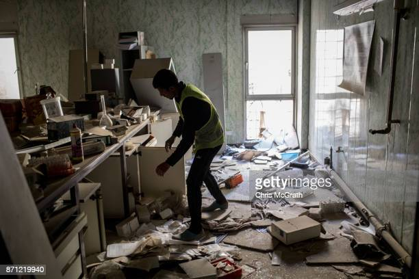 A volunteer looks for useful medical items inside the destroyed Salam Hospital on November 5 2017 in Mosul Iraq Salam Hospital Mosul's main hosptal...