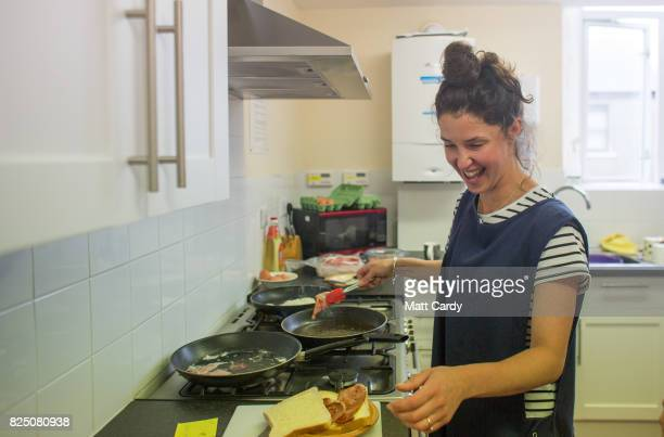 A volunteer makes bacon sandwiches at the Salvation Army's weekly drop in morning which coincides with a foodbank run by the local charity...