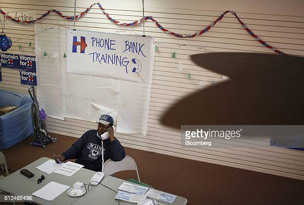 A volunteer makes phone calls to voters at a Hillary Clinton former Secretary of State and 2016 Democratic presidential candidate campaign field...