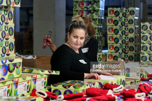 Volunteer Mary Maarouf at Santa's secret warehouse at Rexdale Boulevard