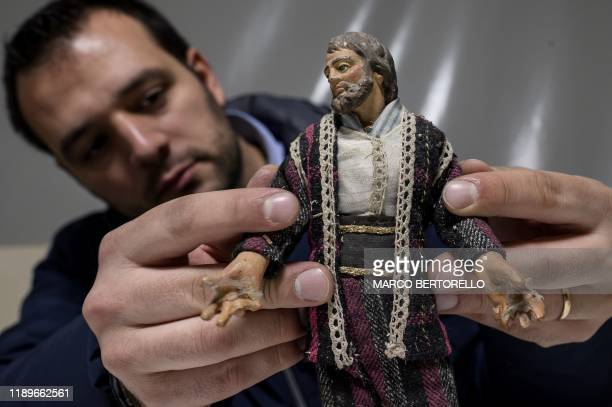 Volunteer Matteo Seia prepares a nativity figure for the 43rd edition of the Presepio of Cavallermaggiore a 300sqm Christmas Nativity crib in the...