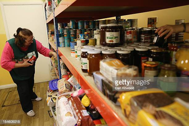 Volunteer Maureen Wiltshire puts together a parcel of food at a Food Bank depot at St Paul's Church in Brixton on October 23 2012 in London England...