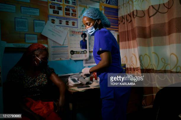 TOPSHOT Volunteer nurse Anita Thumbi who is also an elected Member of County Assembly in the Nairobi County Government attends to a patient at a...