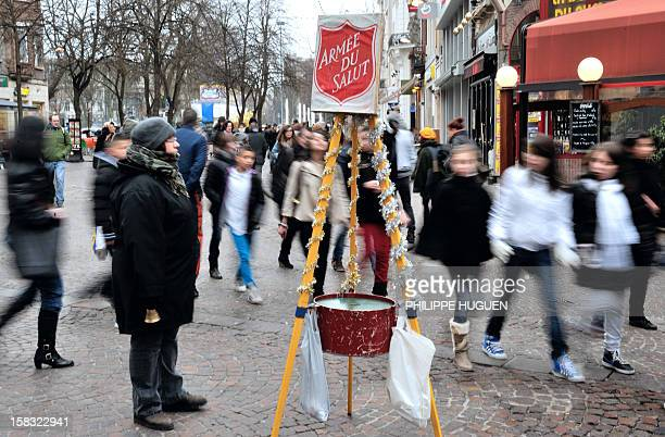 A volunteer of the French Armee du Salut asks for money in the street on December 13 2012 in Lille northern France AFP PHOTO PHILIPPE HUGUEN