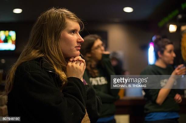 A volunteer of the Hillary Clinton Burlington Iowa campaign field office looks on as Hillary Clinton speaks on the television at the Boogaloo Cafe on...