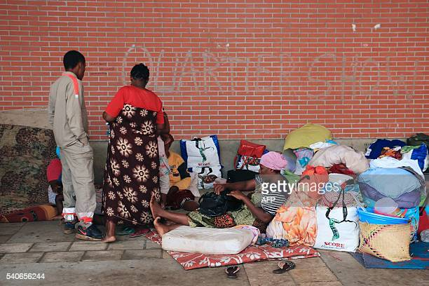 A volunteer of the Red Cross visits migrants and refugees in the makeshift camp on the Place de la Republique in Mamoudzou the capital of Mayotte on...