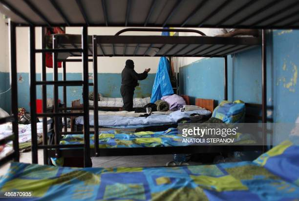 """Volunteer of the Ukrainian battalion """"Donbass"""" stands in the dormitory at their camp on the border between Dnipropetrovsk and Donetsk regions on..."""