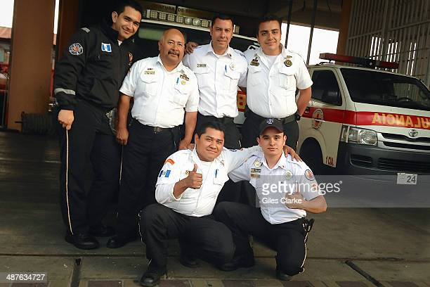 Volunteer paramedics pose for a group portrait January 21 2014 in Guatemala City Guatemala The bomberos voluntarios are a volunteer fire fighting and...