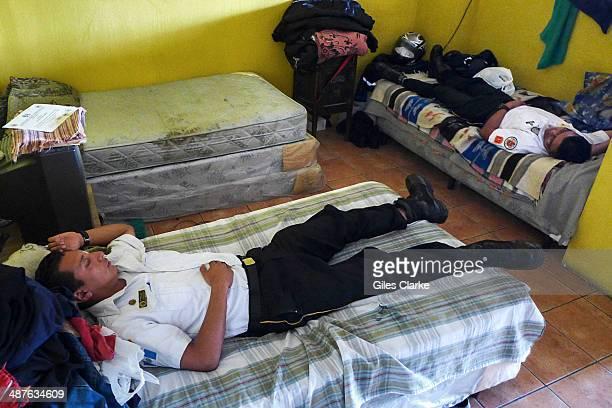 Volunteer paramedics take a nap in the main ambulance station December 11 2013 in Guatemala City Guatemala The bomberos voluntarios are a volunteer...