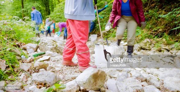 girl woman collecting plastic rubbish bucket