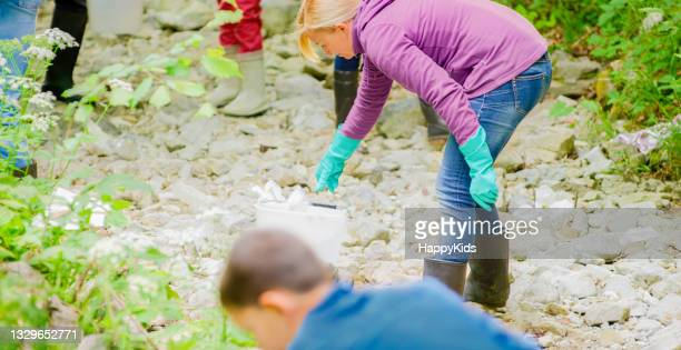 side view mature woman collecting plastic