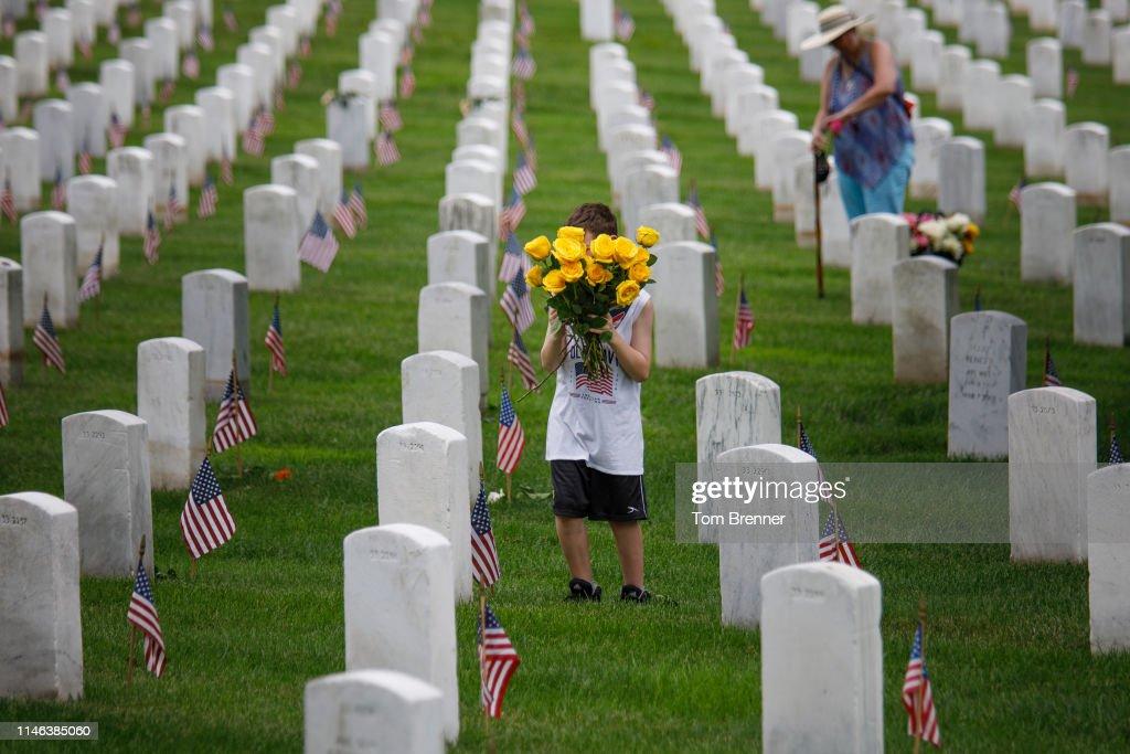 VA: Volunteers Place Flowers On Gravesites At Arlington National Cemetery Ahead Of Memorial Day