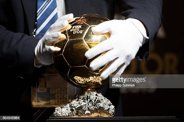 A volunteer places the FIFA Ballon d'Or trophy on a display for a press conference prior to the FIFA Ballon d'Or Gala 2015 at the Kongresshaus on...