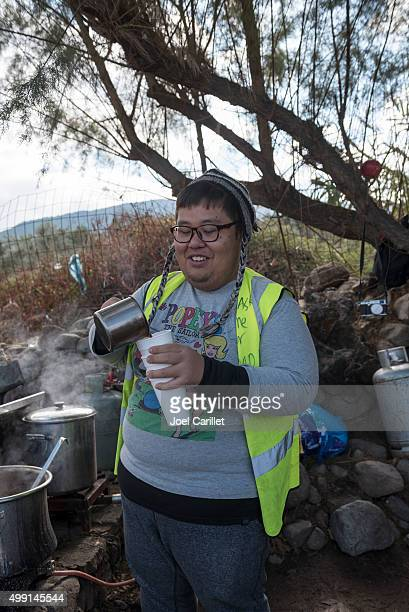 Volunteer pouring tea for refugees on Lesbos, Greece