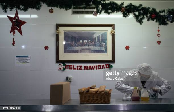 Volunteer prepare tuppers with food in the soup kitchen of the parish of El Carmen on Christmas Day on December 25, 2020 in Zaragoza, Spain. A new...