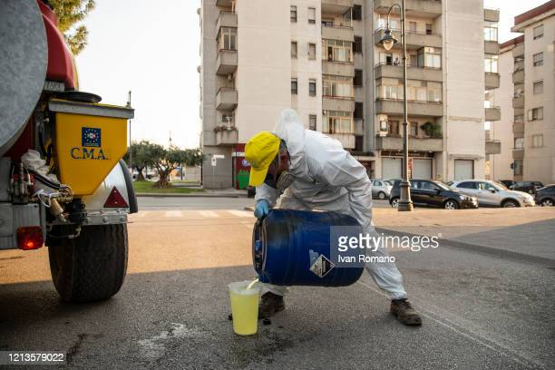 A volunteer prepares a disinfectant solution during a road sanitation initiative on March 19 2020 in Pontecagnano Faiano Italy Italian Government...