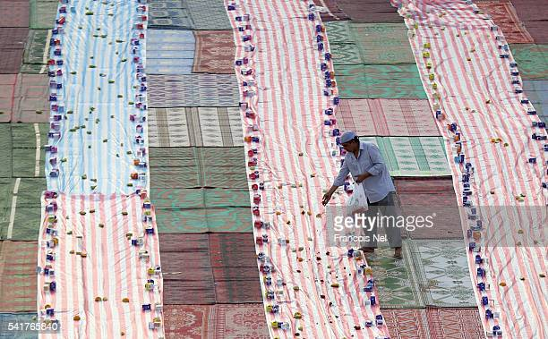 A volunteer prepares food for Iftar the evening meal to break fast during the holy month of Ramadan on June 20 2016 in Dubai United Arab Emirates...