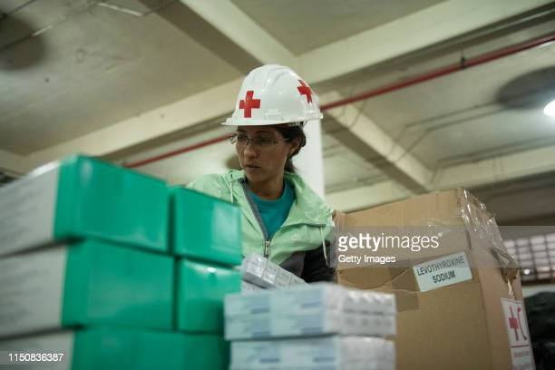 Volunteer repack medicines in a warehouse of International Committee of the Red Cross on June 19, 2019 in Caracas, Venezuela. A second shipment...