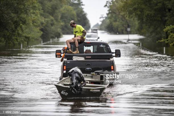 A volunteer rescue worker travels along a flooded highway following Tropical Storm Imelda in Fannett Texas US on Friday Sept 20 2019 The remnants of...