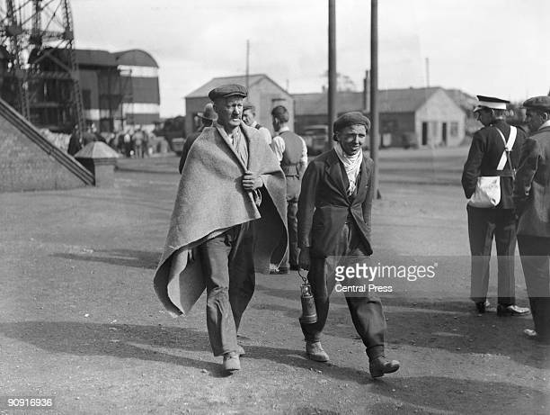 Volunteer rescue workers leave the pithead at Gresford Colliery near Wrexham in Wales 24th September 1934 Two days earlier an underground explosion...