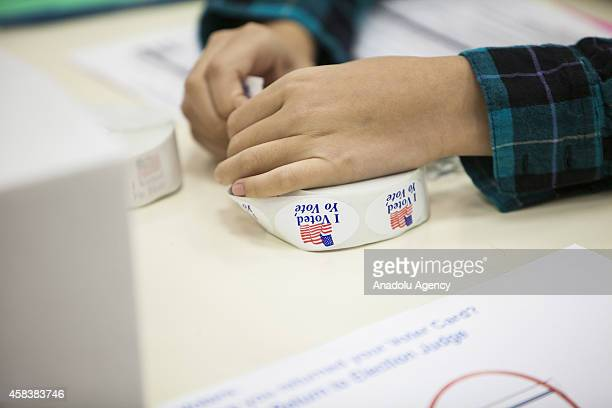 November 4: A volunteer rips off a 'I Voted' sticker at a polling station within US mid-term elections in Rockville, Maryland, United States on...