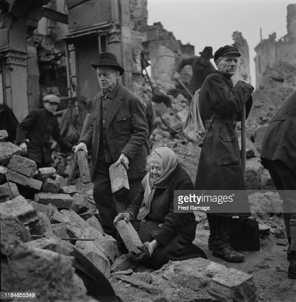 Volunteer rubble-clearers Gustav and Almar Piltz are among the people clearing away the bricks in Dresden, in the German Democratic Republic after...
