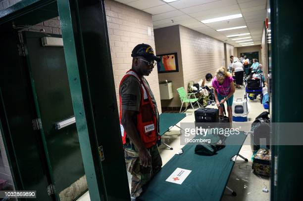 A volunteer sets up cots at a temporary Red Cross shelter ahead of Hurricane Florence at Conway High School in Conway South Carolina US on Thursday...