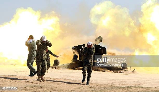 Volunteer Shiite fighters, known as the Popular Mobilisation units, who support the Iraqi government forces in the combat against the Islamic State...