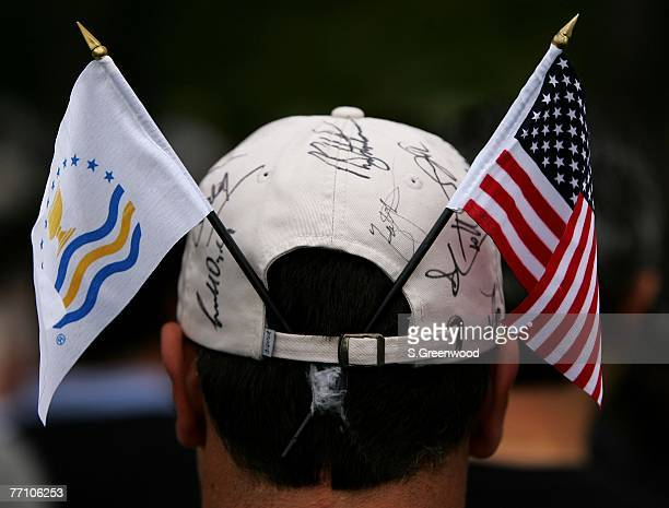 Volunteer shows hi support during the round 2 fourball matches of The Presidents Cup on September 28 at The Royal Montreal Golf Club in Montreal,...