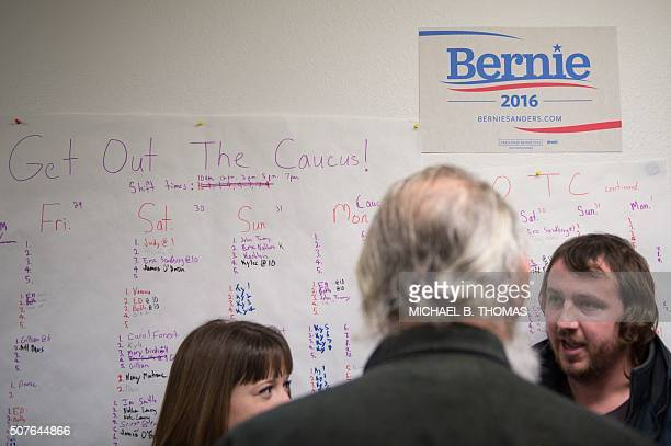 A volunteer sign up poster is seen as volunteers gather at the Bernie Sanders Campaign field office after canvasing the community for support of...