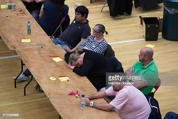 A volunteer sleeps at the Cardiff count which is being held at the Sport Wales National Centre on May 8 2015 in Cardiff Wales The United Kingdom has...