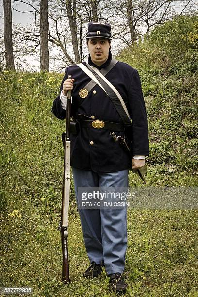 Volunteer soldier of the Union army with muzzleloading percussion rifle American Civil War 19th century Historical reenactment