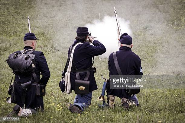 Volunteer soldiers of the Union army firing their muzzleloading percussion rifles American Civil War 19th century Historical reenactment