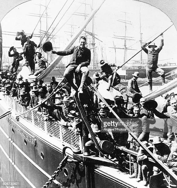 Volunteer soldiers smile for a portrait on the deck of the transport 'Rio de Janiero' as it leaves for Manila during the SpanishAmerican War from San...