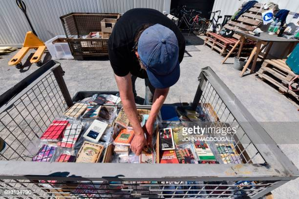 A volunteer sorts through books about to be fixed onto the 'Parthenon of Books' by Argentinian artist Marta Minujin at the Documenta 14 art...