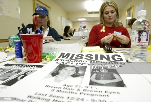 Volunteer Stacey Boyers folds yellow ribbons near a bottle displaying a label with a picture of the missing Laci Peterson January 4 2003 in Modesto...