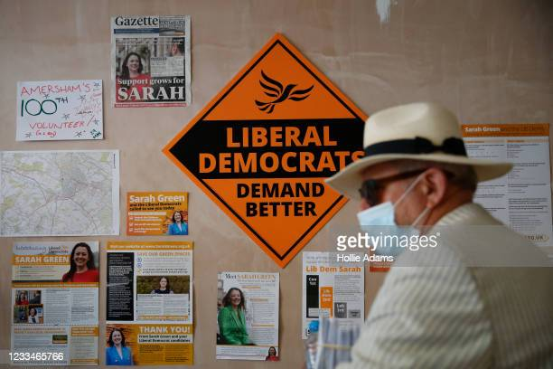 Volunteer stands in front of a Liberal Democrats sign at the headquarters of Liberal Democrats candidate Sarah Green on June 15, 2021 in Amersham,...