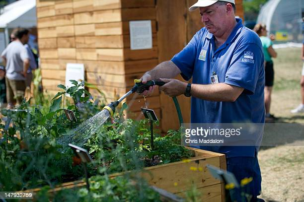 USDA volunteer Steve Lombardi waters an accessible garden at the annual Smithsonian Folklife Festival on the Mall One of this year's themes is Campus...