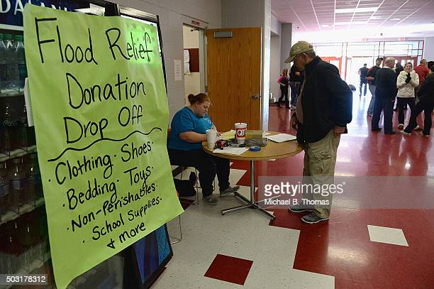 Volunteer students and staff hold a flood relief donation drive at Fox High School on January 2 2016 in Arnold Missouri to help people displaced by...
