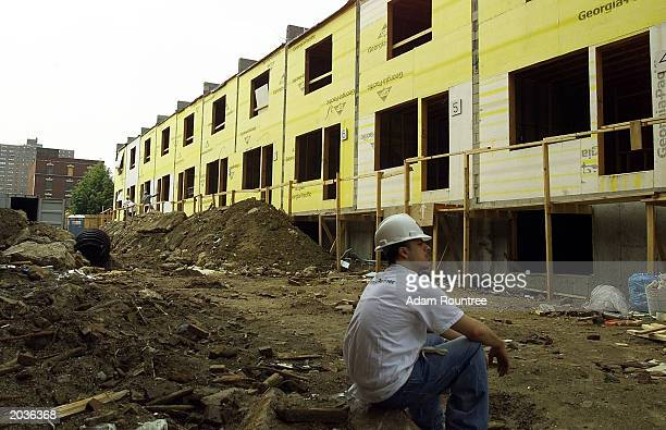 A volunteer takes a brake from building a Habitat for Humanity house May 28 2003 in Bronx neighborhood of New York City Habitat for Humanity is...