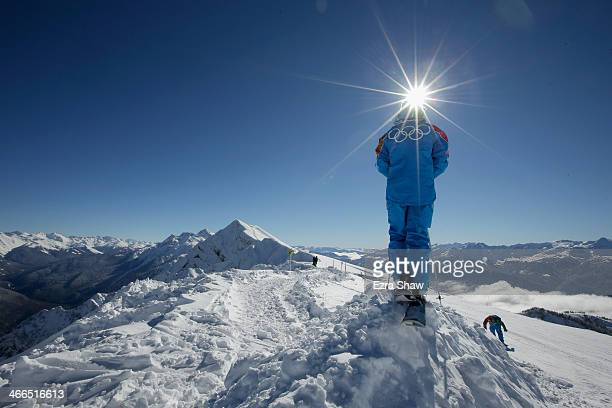 Volunteer takes in the view from the top of the Rosa Khutor ski mountain ahead of the Sochi 2014 Winter Olympics on February 2, 2014 in Sochi, Russia.