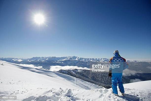 A volunteer takes in the view from the top of the Rosa Khutor ski mountain ahead of the Sochi 2014 Winter Olympics on February 2 2014 in Sochi Russia