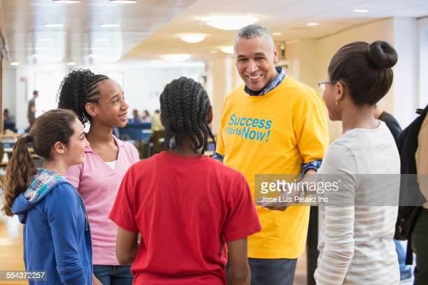 Volunteer talking to children in community center