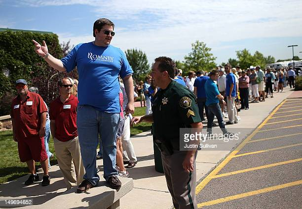 A volunteer talks to a police officer as supporters line up to enter a campaign rally for Republican presidential candidate former Massachusetts Gov...