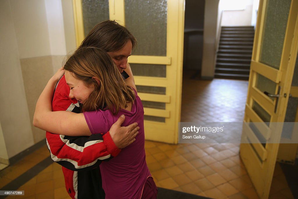Volunteer teacher Eva Domaschke gets a hug from 6th grader Sophie Herbig, 12, before leaving for the day after teaching a geography class at the Middle School on May 14, 2014 in Seifhennersdorf, Germany. The state of Saxony officially closed the Seifhennersdorf Middle School in 2012 after only 38 students registered, two short of the 40 the state required to keep the school open. Rather than agree to the school's closing, a group of parents and other volunteers have since assumed the duties of teachers and staff themselves and are trying to get recognition of their 'illegal' school through a court case that now lies with Germany's Federal Constitutional Court. Eleven 6th graders attend the school, even though the state does not recognize their enrollment. School closings across Germany have reached epidemic proportions with 6,100 closures between 2003 and 2013, due in large part to Germany's low birth rate, a phenomenon typical across much of Europe. In Saxony the low birth rate has combined with a steady migration of young people to big cities and to western Germany and the number of schoolchildren has fallen by close to 50% and led to the closure of 1,000 out of a total of 2,500 state schools since 1989.