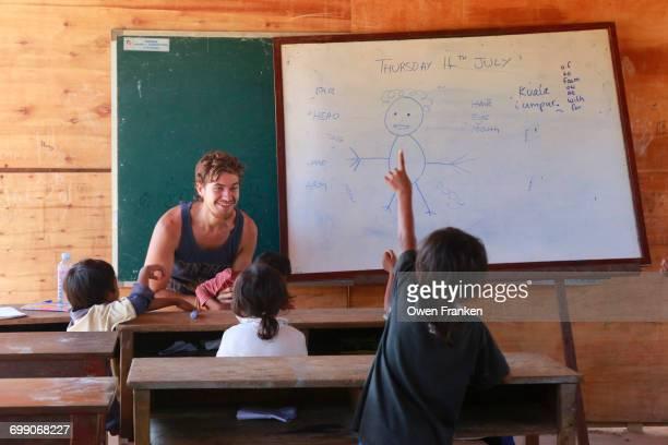Volunteer teaching English in rural Cambodia