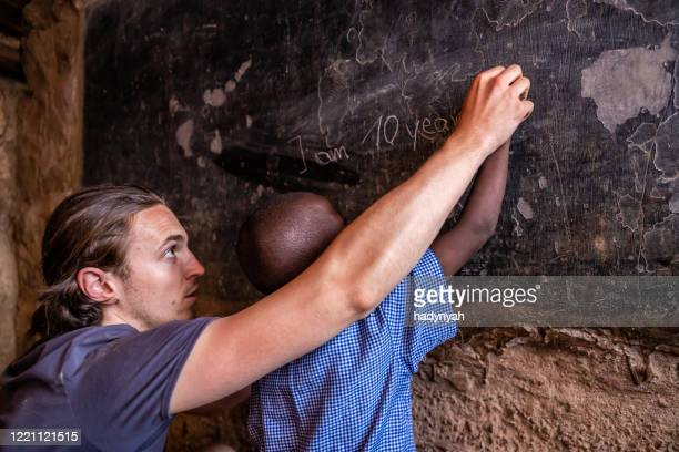 volunteer teaching in africa, orphanage in kenya - africa stock pictures, royalty-free photos & images