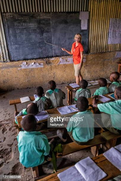 volunteer teaching in africa, school near masai mara game reserve in kenya - east african tribe stock pictures, royalty-free photos & images