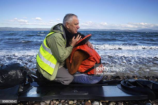 Volunteer Thor Floss from VesteroyNorway comforts refugees who are crying completely traumatized by their boat journey from Turkey to Greece October...
