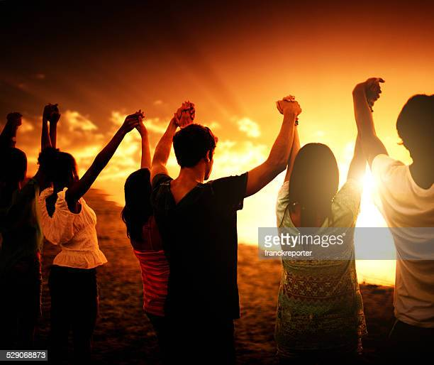 volunteer togetherness at dusk - global village stock pictures, royalty-free photos & images